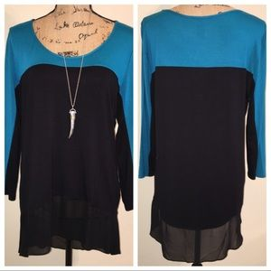 Coco Bianco scoop neck top with hi lo chiffon hem.